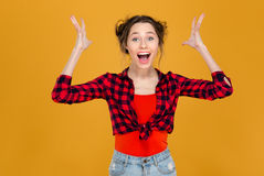 Happy successful excited beautiful young woman shouting with raised hands Royalty Free Stock Images