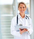 Happy successful female doctor Stock Photo