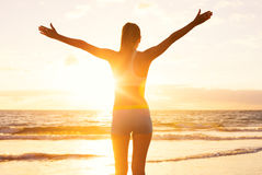 Happy Successful Fitness Woman at Susnet. Success Concept. Happy successful fitness woman raising arms to the sky at sunset. Success, celebrating goals and royalty free stock images