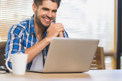 Happy successful freelancer just doing his job and receiving mon Stock Image