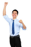 Happy successful gesturing businessman Stock Photo