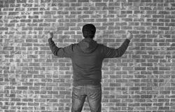 Happy and successful man cheering with his arms against wall,black and white Stock Photography