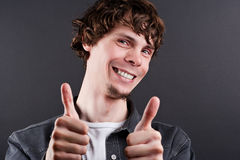 Successful man showing thumbs up Royalty Free Stock Photography
