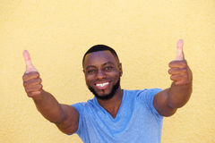 Happy successful man with two thumbs up Stock Photo