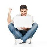 Happy successful man working on laptop Stock Images