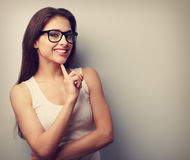 Happy successful smiling young woman in glasses thinking. Vintage portrait. With empty copy space royalty free stock photography