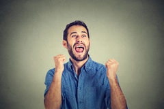 Happy successful student, business man winning, fists pumped celebrating success Stock Images