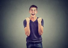 Happy successful student man winning, fists pumped celebrating success royalty free stock images