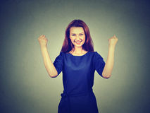 Happy successful student, woman winning, fists pumped celebrating success Stock Photo