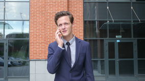 Happy Successful Walking Businessman Talking on Phone, Outdoor stock video