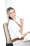 Happy successful woman sitting Stock Photography