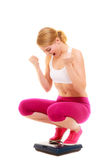 Happy successful woman weighing scale. Dieting. Stock Photography