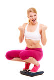 Happy successful woman weighing scale. Dieting. Royalty Free Stock Image