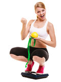 Happy successful woman weighing scale. Weight loss Stock Image