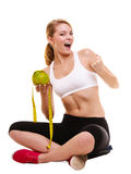 Happy successful woman weighing scale. Weight loss Stock Images
