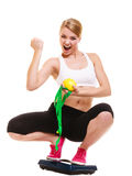 Happy successful woman weighing scale. Weight loss Stock Photo