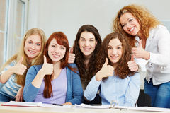Happy successful women holding Stock Image