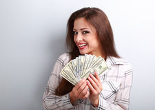 Happy successful yound woman holding dollars in hands with tooth Stock Images