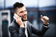 Happy successful young business man Stock Images
