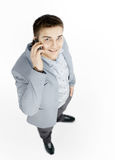Happy successful young businessman talking on mobile phone Royalty Free Stock Images