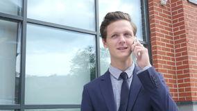Happy Successful Young Businessman Talking on Phone, Outdoor stock footage