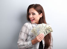 Happy successful young pretty woman holding dollars in hands wit Stock Images