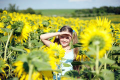Happy summer. A little girl in the field of sunflowers royalty free stock photo