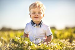 Happy summer boy. Outdoor in sunny day Royalty Free Stock Photo