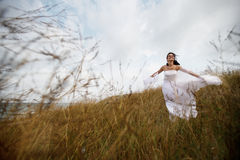 Happy summer bride in nature Royalty Free Stock Image