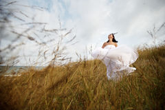 Happy summer bride in nature Stock Photos