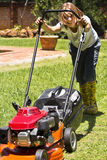 Happy Summer Chores - Mowing Lawn. As the summer rains start, so to do the regular chores of mowing the lawn, etc Stock Image
