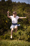 Happy summer girl teenager jumping outdoor. Stock Photography