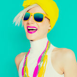Happy summer girl in trendy bright accessories. On blue background Stock Image