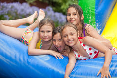 Happy summer. Happy girls in inflatable pool royalty free stock photo