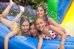 Happy summer. Happy girls in inflatable pool royalty free stock image