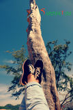 Happy summer holiday, legs up to sky Stock Photography