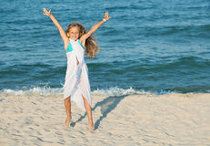 Happy summer jump by the sea on the beach Stock Photo