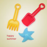 Happy summer. Picture of some beach toys, as a shovel or a rake, on a beige background, with a retro effect stock photos