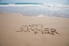 Happy summer text in sand beach with ocean Royalty Free Stock Photography