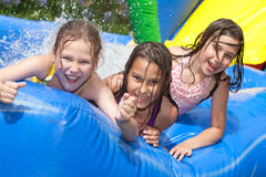 Happy summer. Three girls in inflatable swimming pool stock images