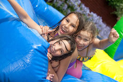 Happy summer. Three girls in inflatable swimming pool royalty free stock images