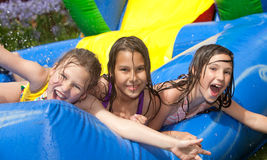 Happy summer. Three girls in inflatable swimming pool stock photo