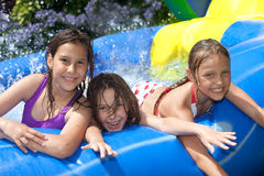 Happy summer. Three girls in inflatable swimming pool royalty free stock photos
