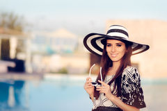 Happy Summer Woman With Big Sunhat by the Pool Royalty Free Stock Images
