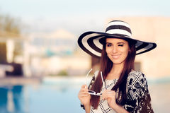 Happy Summer Woman With Big Sunhat by the Pool Stock Photo