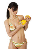 Happy summer woman in bikini with oranges. Stock Photos