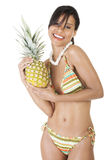 Happy summer woman in bikini with pineapple. Royalty Free Stock Image
