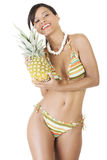Happy summer woman in bikini with pineapple. Royalty Free Stock Images