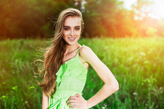 Happy summer woman posing in the meadow outdoors Stock Photos