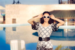 Happy Summer Woman With Sunglasses by the Pool Royalty Free Stock Photography